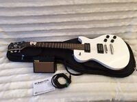 White Les Paul style guitar, case and practice amp - Last One