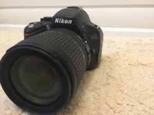 """Nikon D5100 DSLR"" with 18-105 Lens, Strap, Accessories"