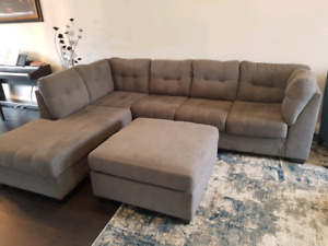 Almost brand new Ashley sectional couch and ottoman!