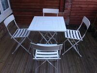 Folding white metal table and chairs