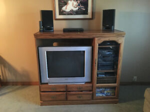 Sony tv with oak entertainment centre, in decent shape..
