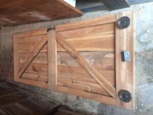 Solid cherry wood barn door including hardware