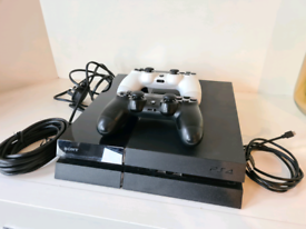 PS4 Console, two controllers, cords, games