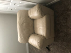 Three leather piece beige sofa, love seat,and chair