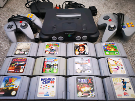 N64 with 12 games and 2 controllers. Zelda, mario kart, Mario world