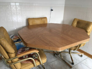 Wood table and four swivel chairs