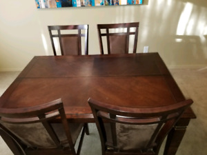 Dining room table and eight chairs.