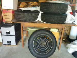4 Uniroyal 16 inch Snow Tires on Rims