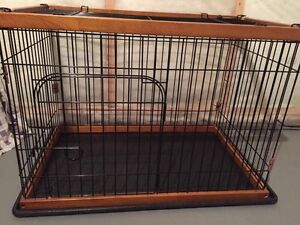 Two dog kennels for sale.