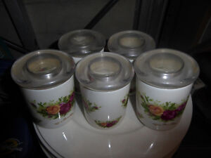 5 smaller ceramic storage containers with glass lid
