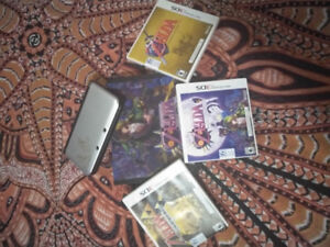 Nintendo 3Ds XL with three Zelda games all in great condition.