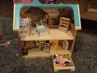 Amazing condition Sylvanian families house, with characters, car and bike.