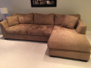 Priced to sell ! beautiful sectional and matching love seat