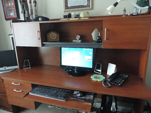 Solid desk with L-shaped run-off
