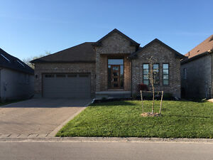 BEAUTIFUL SPACIOUS OPEN CONCEPT HOME WITH WALK OUT BASEMENT