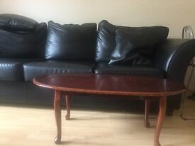 Leather sofa with table
