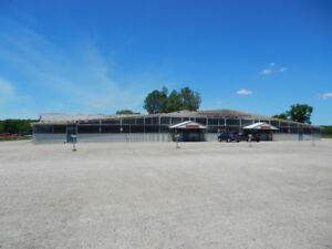 30,000 SQ. FT. COMMERCIAL BUILDING PLUS HOUSE ON 10 ACRES.