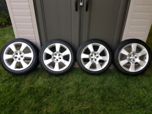 Like New Tires.  215 45 R17 tires with Toyota wheels.
