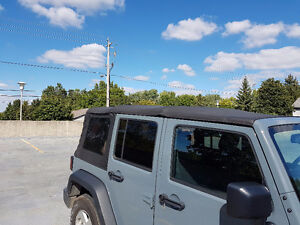 Jeep Wrangler Unlimited OEM Soft Top London Ontario image 4