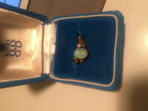 Australia Opal 10k with 2 diamonds great for engagement ring or