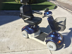 4. WHEEL MP4  MOBILITY SCOOTER  LIKE NEW..