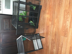 Multiple reptile homes and a fish tank for sale.
