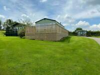 2 bedroom caravan with large decking on a scenic plot.