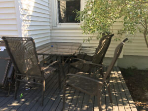 Patio set - glass top table, four chairs