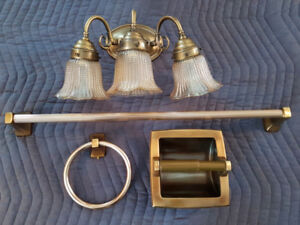 Antique Brass Vanity light with matching bath fixtures