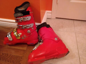 Ski boots, helmet, racing suit and race shorts
