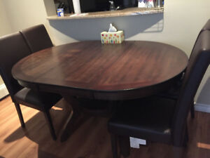 Solid wood dinning table with 4 chairs---last 2 days