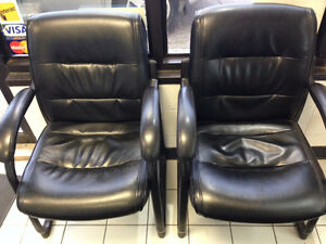 Black leather-upholstered chairs, good used cond., 4 available