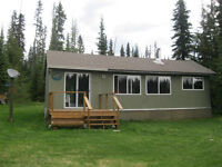 Year round remote cabin for sale on hot fish lake.