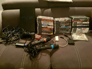 Playstation 2 with accessories and 34 games