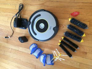 Roomba Vacuum with several new replacement parts