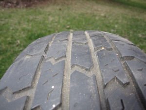 One P185/75R14 Steel Belted All Season Tire