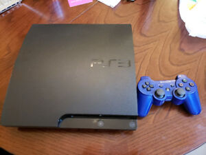 Playstation 3 with controller and 7 games