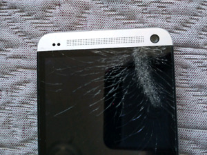 HTC ONE M7 for sale.Broken screen but perfect working condition