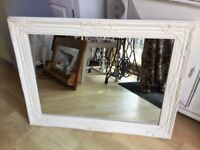 A LARGE IVORY ORNATE MIRROR