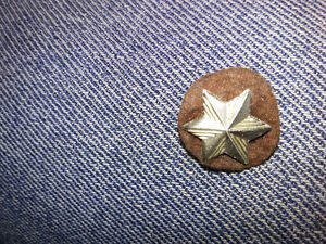 silver 6 point star on brown khaki patch