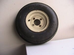 TIRE AND WHEEL IN GOOD CONDITION $50.00 OR BEST OFFER