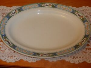 Assiette de service en porcelaine fait par Johnson Bros co. 1913