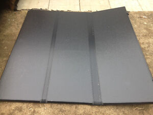 Solid tri-fold tonneau cover off a 2014 ram 1500 with 5.5 ft box