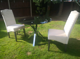 Pair of high back Velvet Amelia dinning chairs with table.