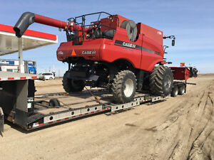 Combine & swather moving! Farm Equipment hauling & towing.