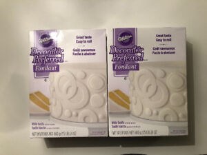 Two packages of unopened Wilton white fondant (1.5lbs x2)