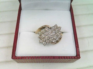 One Lady's 14k Yellow and White Gold Diamond Cluster Ring.