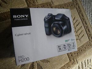 cameras, Sony Cybershot DSCH2000 , Velbon Aluminum tripod, etc.