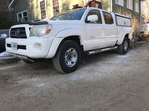 Toyota Tacoma cap and snow tires on rims. TRUCK IS SOLD!
