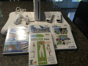 Wii console and Board with a few games